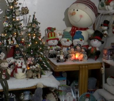 A display of snowman decorations and figurines