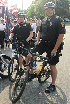 Two Bike officers smiling for camera