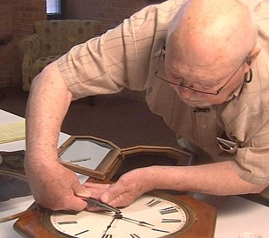 Man repairs an antique clock