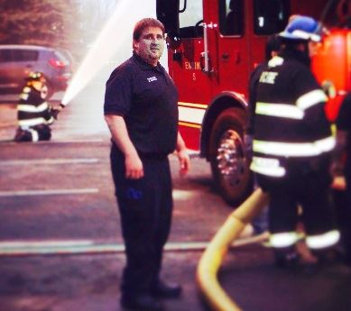 Firefighter standing near a firetruck
